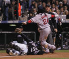 [1794]  Colorado Rockies catcher Yorvit Torrealba holds the ball out to home plate umpire Ted...