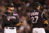 [1920]  Colorado Rockies infielders Troy Tulowitzki, left, and Garrett Atkins wait as Franklin...