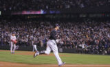 [3047]  Colorado Rockies Matt Holliday trots around the bases after hitting a homerun in the sixth...