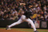 [2459]  Colorado Rockies pitcher Jeremy Affeldt delivers a pitch to  Boston Red Sox Dustin Pedroia...