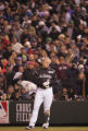 [3797]  Colorado Rockies Matt Holliday stands on the first base line after a long fly out to end...