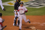 [3197]  Boston Red Sox Julio Lugo looks back as he scores on a double to right field by Jacoby...