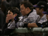 [RMN875] Colorado Rockies Todd Helton and Jeff Baker watch from the dugout as Brad Hawpe comes up...