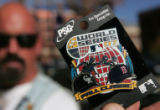 Jim Maser sells licensed pins and ticket holders outside of Coors Field Thursday  October 25,...