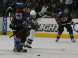 The Colorado Avalanche, Tyler Arnason,#39 is hooked from behind by Minnesota Wild, Mikko Koivu,...