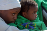 (from left) Sadia Yahia (cq) holds her friend's son, 1 year-old Ziryab Khamis (cq), at a...