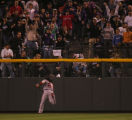[5104]  Boston Red Sox left fielder Manny Ramirez tries to catch up to a double hit by Kaz Matsui...