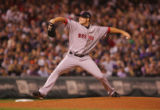 [5195]   Boston Red Sox pitcher Jon Lester delivers a pitch in the second inning of Game 4 of the...