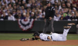 [5463]  Colorado Rockies Todd Helton dives but can't reach the ball hit by Boston Red Sox Jason...