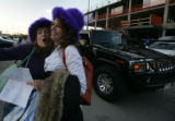 After getting out of their limo- Cheri Nissen (cq)and Joie Petrie (cq)of Longmont cheer for their...