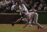 [728} Colorado Rockies, Aaron Cook, sprints for 1st base as the ball skips past Boston Red Sox...