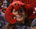 [1435] Red Sox fan wears a lobster hat after Game 4 of the World Series at Coors Field in Denver...