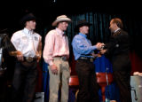 (Denver, Colo., Oct. 27, 2007) Josh, Jeremiah, and John Peek give Lee Greenwood (right) a rodeo...
