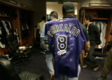 0526 Colorado Rockies Yorvit Torrealba heads out of the clubhouse after cleaning out his locker...