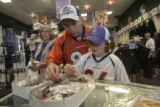 Michael Leisle ,right, and his dad, Dan Leisle (cq), look at World Series pins, Monday afternoon,...