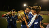 Cherry Creek's  team members cheer as the carry the State Champion trophy at All City Stadium in...