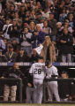 [6253]  Colorado Rockies teammates and fans congratulate Aaron Cook as he leaves the game in the...