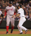 [6307]  Colorado Rockies first baseman Todd Helton tags out Boston Red Sox Jason Varitek on an...