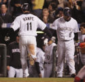 [6366]  Colorado Rockies Brad Hawpe is congratulated by Yorvit Torrealba after Hawpe hit a homerun...