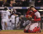 [6372]  Boston Red Sox Jason Varitek adjusts his helmet after Colorado Rockies Brad Hawpe, left,...