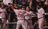 [6558]  Boston Red Sox Mike Lowell is congratulated by teammates after his homerun in the seventh...