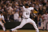 [7041]  Colorado Rockies pitcher Manny Corpas strikes out Boston Red Sox batter Manny Ramirez in...