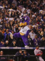 [6874]  Colorado Rockies mascot Dinger tries to rally the fans in the seventh inning of Game 4 of...
