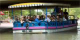 Colorado Gov. Bill Ritter, right, takes a boat tour of the Historic Arkansas Riverwalk Saturday....