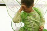 MJM149  Dressed as a fairy, Deyannira Villa, 4, rubs her eyes as she takes part in the annual...