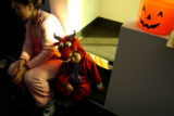 MJM713  Dressed as a dragon, Diego Lopez, 3, sits next to his mother, Maria Orosco (cq), left, as...
