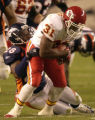 (DENVER, COLO., SEPTEMBER 12, 2004) - Denver Broncos' #28, Kenoy Kennedy, left, drags downa Kansas...