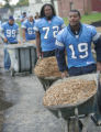 Detroit Lion Players turned out to help build a fitness trail at Dick and Sandy Dauch Campus home...