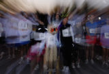 Elizabeth Bollendonk (cq) wears a spider on her head as she lines up with other participants to...