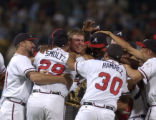 GAJB1O6 - Atlanta Braves' Chipper Jones, center, without hat, celebrates with teammates after the...