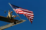 (DENVER, Colo., - SHOT 9/15/2004) Construction workers celebrated the completion of the steel...