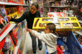 Angel Eugenio Escamilla (cq), 2, points to a toy he wants while his mother  Gabriela Escamilla...