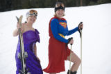 Photo caption: Skiers Laura Harris and Anita Overmyer welcome the ski season at Keystone in...