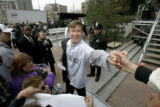 0287 Denver Mayor John Hickenlooper works the crowd and signs autographs as a few members of the...