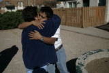 Martin Aranda (cq) gets a comforting hug from family friend Gloria Loera (cq) Nov. 1. 2007,...