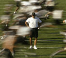 10 August, 2004 -- Missouri head football coach Gary Pinkel watches his team run sprints at the...