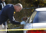 Federal Height  Det. Dean Groff investigator collects evidence at  the crime scene at the Kimberly...