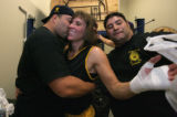 Jim Lopez hugs winner Tiffany Middleton as Joey Rodorte helps untape her hand all with the DPD at...