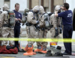 ( DENVER, CO. , May 23, 2004)The  Denver firefighter hazmat  team members assembles outside the...