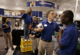 Femi Adeyemi (cq), right, and Armando Diaz (cq), employees at the Best Buy at Colorado Blvd. and...