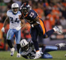 [JOE0994]  Denver Broncos runningback Andre Hall breaks free of  Tennessee Titans Chris Hope (24)...