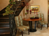 The grand entry has a curved staircase, with table and chairs, in Wissmann's house, Thursday...