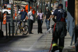 Denver firefighters hose the blood off the sidewalk at the scene of a crime at the corner of 15th...