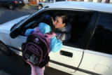 Kitana Aragon, 5, left kisses her mother Jessica Walters after being dropped off outside of...