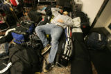 0307  Morgan Frank, 17, takes a quick nap after waiting nearly four hours for fellow teammates to...