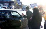 Denver school board candidate Arturo Jimenez (cq),center) at Speer Blvd. and Federal Tuesday...
